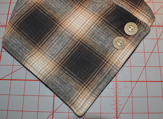 Fold neckwarmer to determine snap position