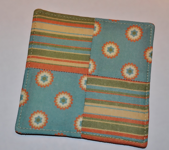 "Finished coaster shown with top stitching 1/8"" from edge"
