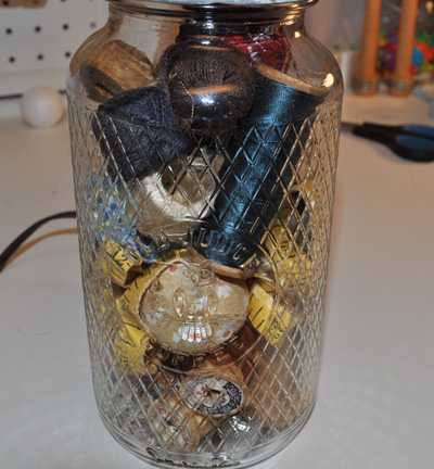 Vintage Sewing Accessories In Glass Jar